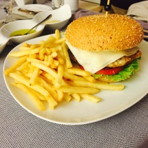 Caesar salad and burger from room service