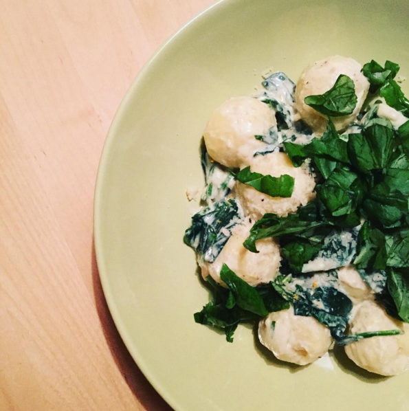 Pumpkin gnocchi in orange, ginger, spinach & ricotta sauce topped with parmesan cheese and fresh basil