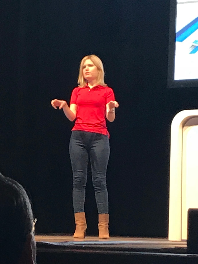 Paige on stage talking about AI and ML